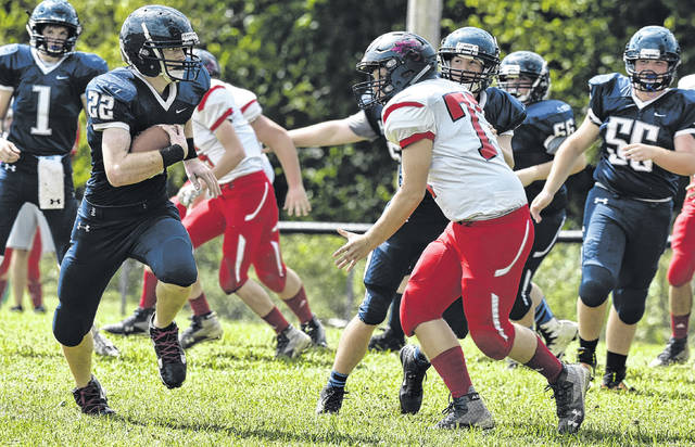 HHS junior Jordan Fitzwater (22) carries the ball during the first quarter of the Wildcats' 42-26 setback against Hundred on Saturday in Ashton, W.Va.