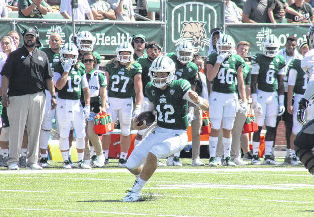 Ohio University junior Nathan Rourke (12) scrambles for a gain, during the Bobcats' win over Howard on Sept. 1 in Athens, Ohio.