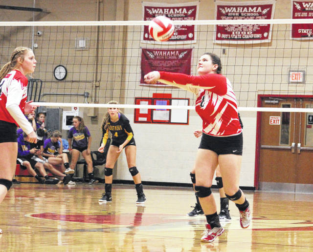 Wahama senior Lexi Layne bumps a ball in the air during Tuesday night's TVC Hocking volleyball match against Southern at Gary Clark Court in Mason, W.Va.