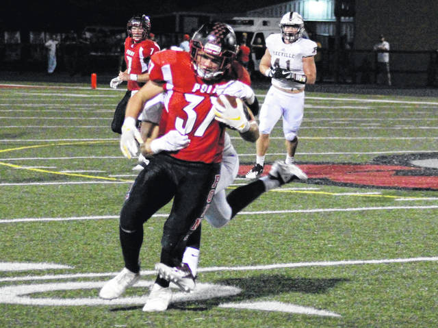PPHS sophomore Joel Beattie (37) fights for yards after a catch, during the Big Blacks' bout against Pikeville on Friday in Point Pleasant, W.Va.