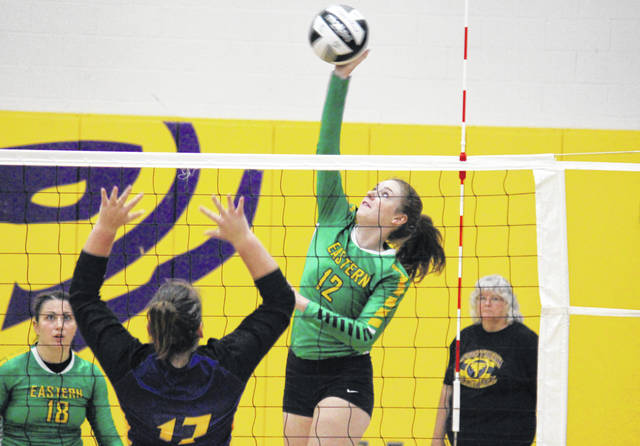 Eastern sophomore Olivia Barber (12) spikes the ball, during the Lady Eagles' win on Tuesday in Racine, Ohio.