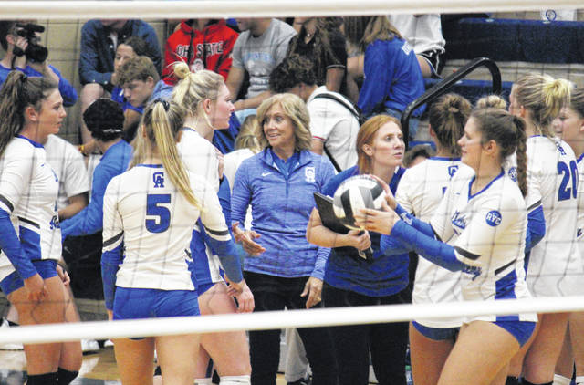 Gallia Academy head volleyball coach Janice Rosier smiles during a break in the action in the Blue Angels' sweep of Chesapeake on Sept. 11, 2018.