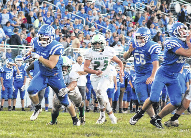 Gallia Academy senior Jacob Campbell (4) rumbles past a pair of Fairland defenders during the first half of Friday night's Week 6 football game against Fairland at Memorial Field in Gallipolis, Ohio.