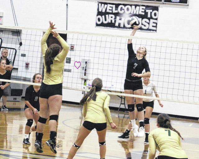 River Valley sophomore Taylor Huck (7) hits a spike attempt during Game 1 of Thursday night's TVC Ohio match against Athens in Bidwell, Ohio.