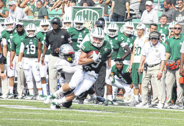 Ohio senior Andrew Meyer (9) shakes off a Bison defender, during the Bobcats' 38-32 victory on Saturday at Peden Stadium in Athens, Ohio.