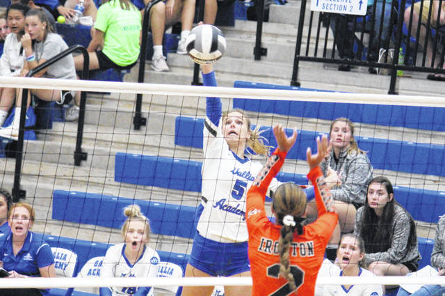 Gallia Academy junior Alex Barnes (5) slams a spike over an Ironton defender, during the Blue Angels' straight games win on Tuesday in Centenary, Ohio.