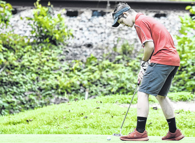 Wahama junior Khyer Bush attempts a putt during a match on August 2 at Riverside Golf Course in Mason County.