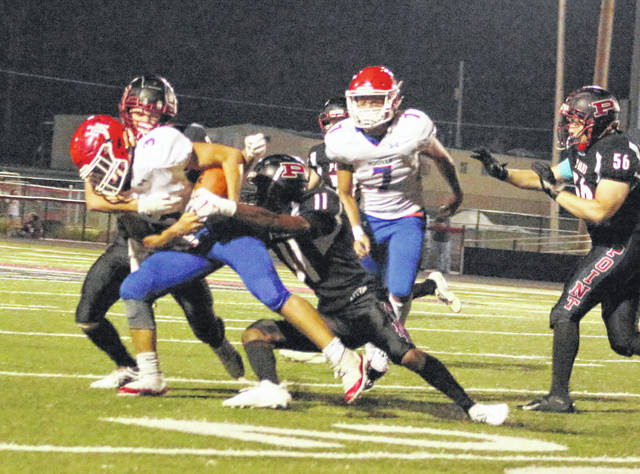 Point Pleasant junior Jovone Johnson (11) and Josh Wamsley combine to bring down Herbert Hoover's Ben Kee (3) during the second quarter of Friday night's Week 4 football contest at OVB Field in Point Pleasant, W.Va.