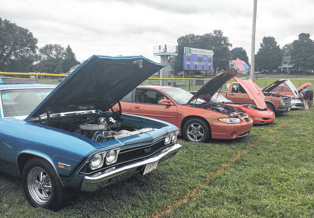 More than two dozen vehicles took part in the annual Cruisin' Saturday Night Car Show during Racine's annual Party in the Park.