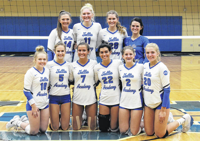 Members of the Gallia Academy volleyball team pose for a photo following the match in which they earned a share of the OVC league title on Thursday in Centenary, Ohio.
