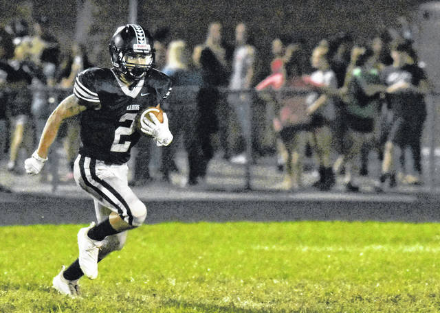 River Valley's Layne Fitch carries the ball during the Raiders Tri Valley Conference Ohio Division contest against Nelsonville-York on Sep. 14 in Bidwell, Ohio.