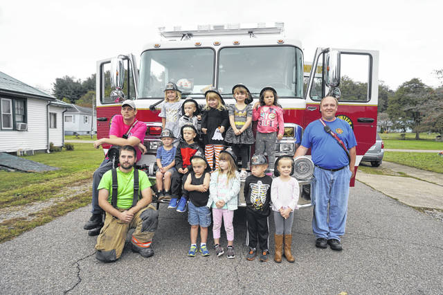 Children attending story hour at the Mason Library were treated to a visit from the Mason Volunteer Fire Department as a part of Fire Prevention Week. The group is pictured with Fire Chief C.R. Blake, back left, Firefighter Dylan Perkins, front left, and Firefighter R.C. Faulk, right.