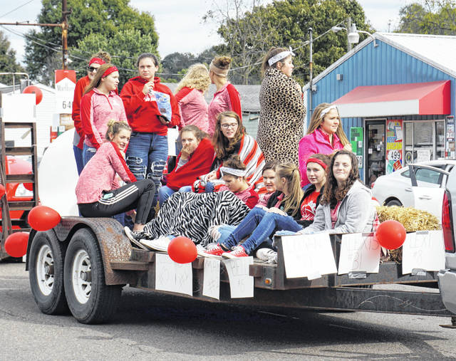 The chill in the air made several Wahama Varsity Volleyball Team members wrap in blankets on the parade route Friday for Homecoming.