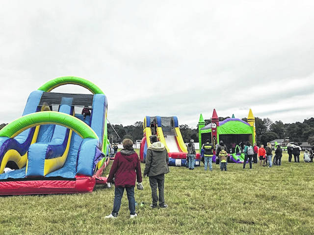 The cool weather didn't keep people away from Community Family Fun Day on Saturday. The annual, free event is provided to the public by the Point Pleasant Volunteer Fire Department. Activities included inflatables for the kids and a fire truck parade through Point Pleasant with several county departments participating in it.