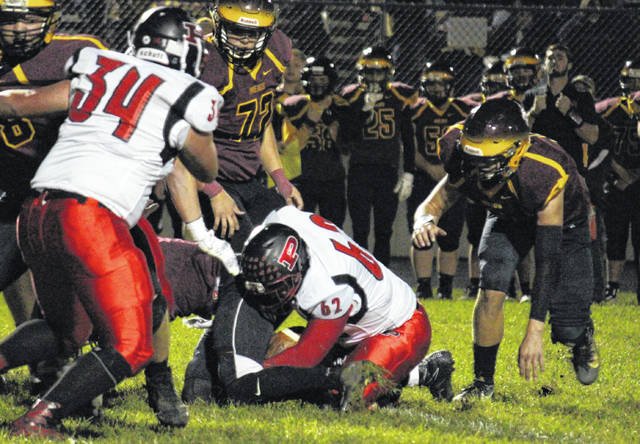 Point Pleasant junior Nate Barth (62) recovers a fumble on the game's opening drive, during the Big Blacks' 55-13 victory on Friday in Rocksprings, Ohio.