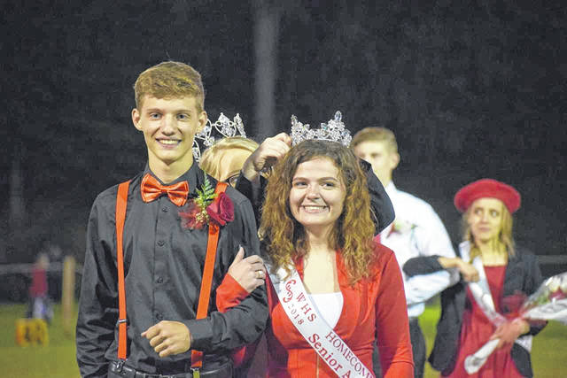 Pictured is 2018 Wahama Homecoming Queen Grace Haddox, along with her escort is Nathan Day. Also pictured, from the Wahama Homecoming Court, from right, Emily and Ethan VanMatre, Hadddox, Day, 2017 Homecoming Queen Destiny Sayre, Heaven Bush and Jonathan Frye. More from Wahama's homecoming parade inside this edition and online at www.mydailyregister.com.