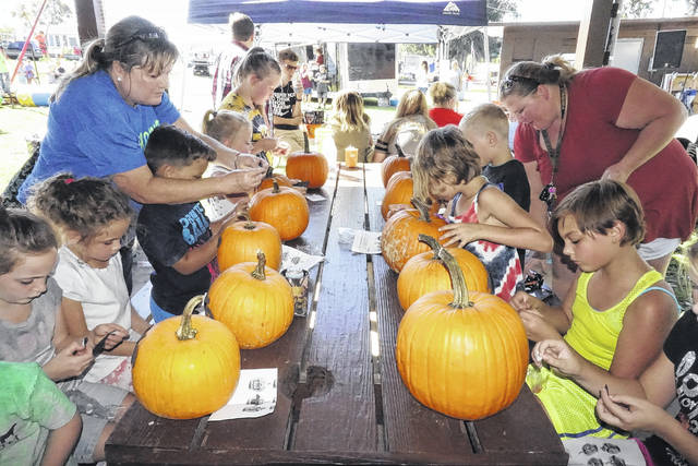 Plans have been finalized for the Mason Harvest Festival, set for Oct. 13, at the Stewart-Johnson V.F.W./Lottie Jenks Memorial Park. The festival includes free, family-friendly activities, like pumpkin painting, pictured here at last year's festival.