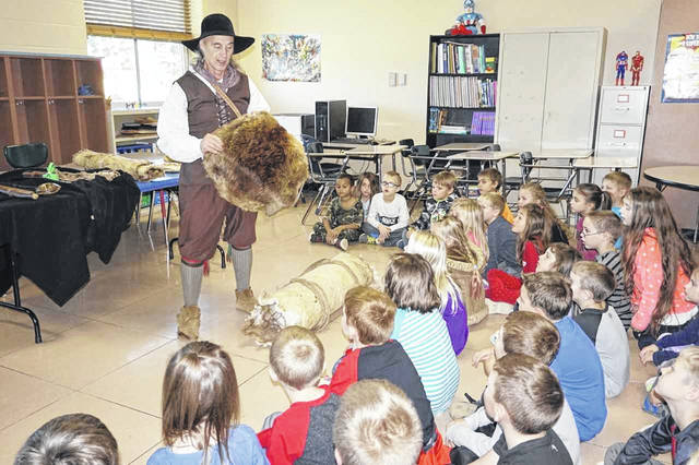 "Doug Wood, portraying Gabriel Arthur, told students about fur trading and other adventures of the early frontier during New Haven Elementary School's ""Heritage Day."" Wood, from Hurricane, is a part of the West Virginia Humanities Council ""History Alive!"" program."