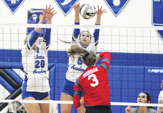 Gallia Academy junior Alex Barnes (5) blocks a spike attempt in between teammates Maddy Petro (20) and Taylor Burnette (right), during the Division II district semifinal on Wednesday in Londonderry, Ohio.