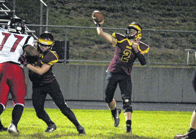 Meigs freshman Coulter Cleland releases a pass behind a block from sophomore Noah Metzger, during the Marauders' setback on Oct. 12 in Rocksprings, Ohio.