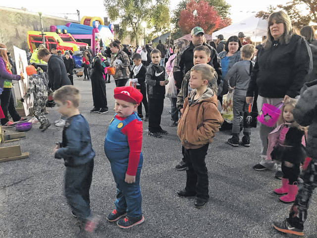 Various Halloween activities and trick-or-treat times have been announced for across Mason County. Pictured is a scene from last year's Point Pleasant Halloween Block Party.