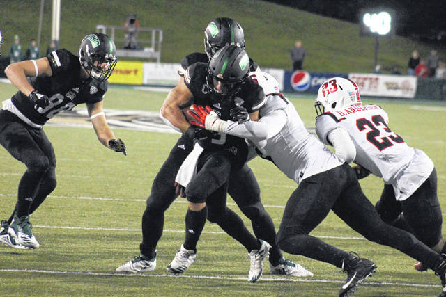 Ohio senior A.J. Ouellette breaks a tackle on his way to the end zone, during the Bobcats' 52-14 victory on Thursday in Athens, Ohio.
