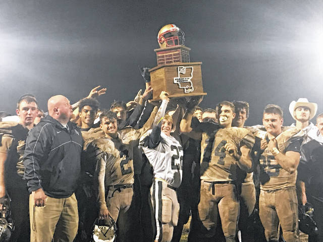 Members of the River Valley football team lift the first Clash of the County championship trophy on Saturday night following an 8-0 victory over host South Gallia in a Week 10 battle of Gallia County teams in Mercerville, Ohio.