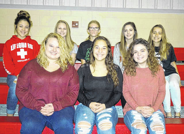 One of three senior girls will be crowned the Wahama Homecoming Queen during halftime of the school's football game on Oct. 12. Pictured in the front row, from left, are queen candidates Heaven Bush, Emily VanMatre, and Grace Haddox. Back row, from left, are attendants Lillian Bowles, seventh grade; Makenna Harrison, eighth grade; Kailyn Weaver, freshman; Autumn Beckner, sophomore; and Olivia Johnson, junior.