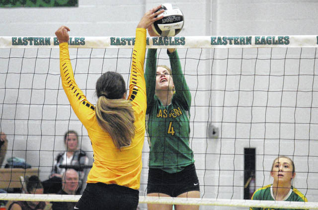 Eastern sophomore Jenna Chadwell (4) blocks Marissa Noble's spike attempt, during the Lady Eagles' victory on Wednesday in Tuppers Plains, Ohio.