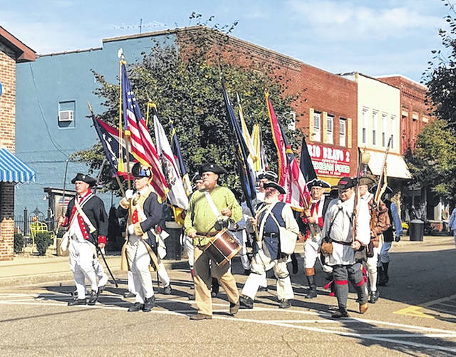 The Sons of the American Revolution carry the colors during the Battle Days Parade.
