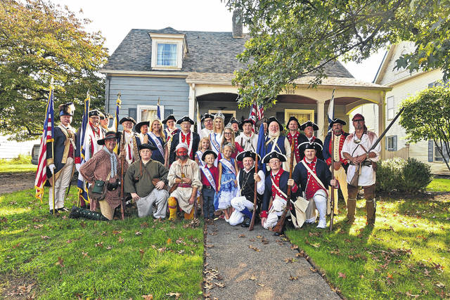 """The past meets the present in this photo taken not in 1774, but in 2018 along Main Street Point Pleasant during the lineup for the annual Battle Days Parade on Saturday. Pictured are members of the Sons of the American Revolution, the 2018 Battle Days Royal Court, historic reenactors and more as they pose for a photo before """"stepping off"""" and on to the parade route. More from Battle Days inside this edition and online at www.mydailyregister.com."""