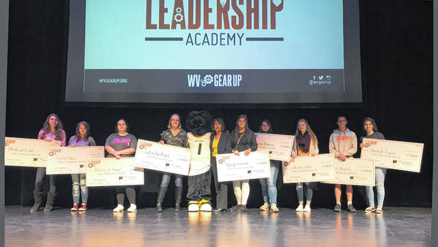 West Liberty University awarded nine West Virginia Gear Up students with a $1,000 scholarship to use if they attend the university. Pictured from left to right are Madison Law, Rachel Bess, Kimberly Stover, Latasha Acord, Topper the Bear, Brenda King, Haliegh Bowman, Samantha Adamini, Lakelyn Sexton, Seth Moore, and Hannah Trippett.