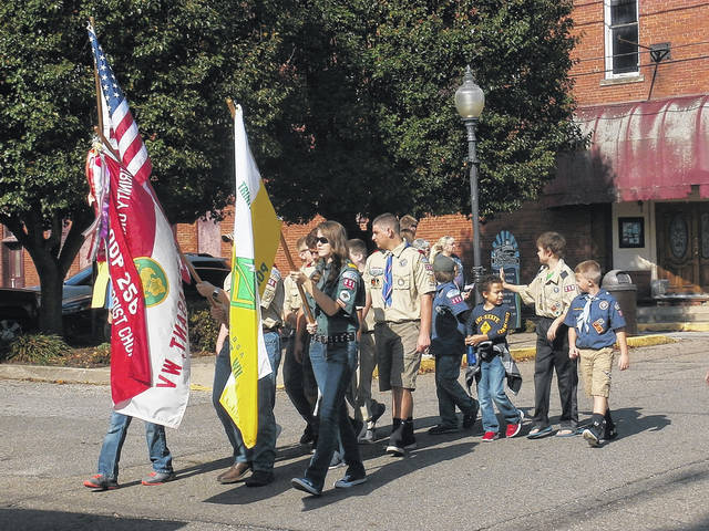 Several residents came out to show their respect by supporting the annual AMVETS Veterans Day Parade in downtown Point Pleasant last year, pictured are area Boy Scouts and Cub Scouts marching in the parade as a show of support and respect.