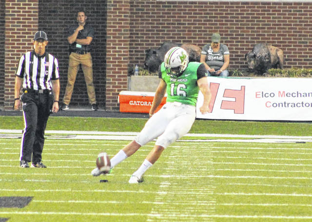 Marshall kicker Justin Rohrwasser (16) puts a boot on the ball during a Sept. 8 football game against Eastern Kentucky at Joan C. Edwards Stadium in Huntington, W.Va.