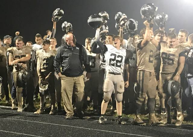 River Valley football coach Jason Peck smiles as his Raiders celebrate their first first win of the year during Saturday night's first-ever Clash in the County football contest against South Gallia in Mercerville, Ohio. (Bryan Walters|OVP Sports)