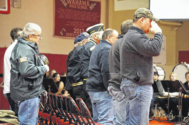 "Some of the veterans who attended a service in their honor at Wahama Friday, are shown as they listen to a trumpet solo of ""Taps,"" played by Carl Sayre."
