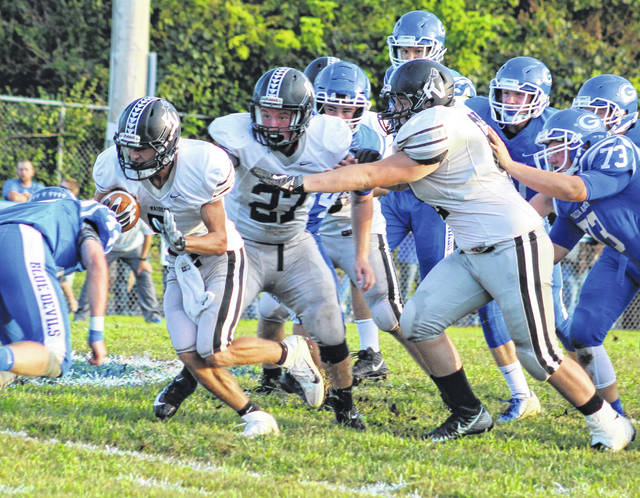 River Valley junior Jared Reese, left, breaks away from the line of scrimmage during a Week 2 football contest against Gallia Academy at Memorial Field in Gallipolis, Ohio.