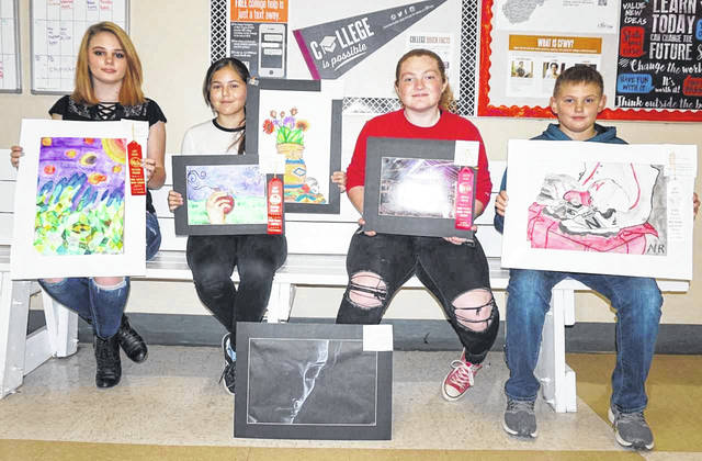 Five Wahama High School art students placed in the show at the West Virginia Black Walnut Festival recently. Pictured, from left, are Addisyn Williams, second place high school painting; Selene Aguirre, second place middle school drawing and second place middle school painting; Emma Haddox, second place high school photography; and Nikolas Roush, third place middle school painting. Pictured at the bottom is the high school honorable mention drawing work of Reese Roush, who was absent.