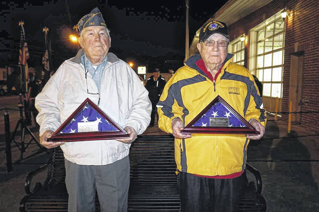 "Two veterans received special recognition during the Veterans Day program in New Haven Sunday. Pictured are Grayson ""Pat"" Williamson, left, a veteran of the U.S. Army, and George E. Carson, a U.S. Air Force veteran. They were presented American Flags encased in glass presentation boxes."