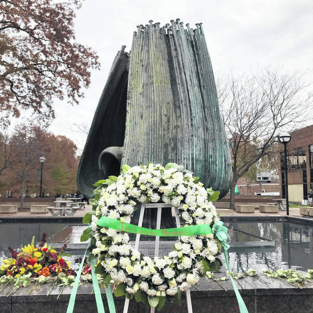 "Every November 14, ""the 75"" are remembered. ""The 75"" being players, coaches, members of the flight crew and boosters of the Marshall University Thundering Herd football team who perished in a plane crash on November 14, 1970. On Wednesday, the 48th annual Memorial Fountain Ceremony honoring those who lost their lives was once again held on the Memorial Student Center Plaza in Huntington. Pictured are scenes from the ceremony, including Thomas Slusher laying a white rose in remembrance at the fountain which is turned off during the service. Slusher is a great nephew to the late Barry Nash who played for The Herd, graduated from Point Pleasant High School in 1969 and perished in the crash."