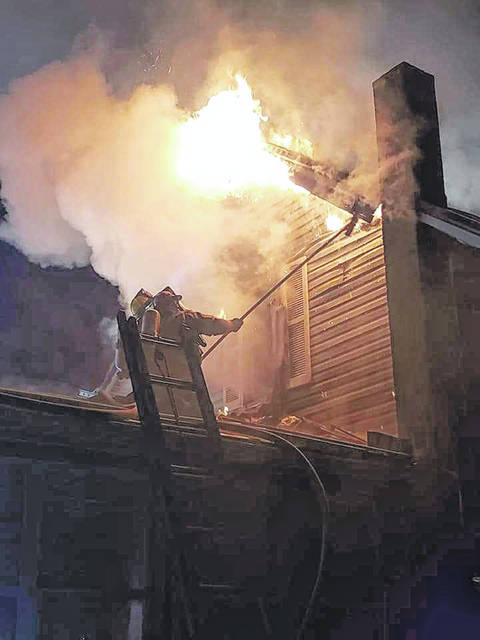 An early morning fire on Sunday caused substantial damage to a house on Third Street in Mason, which was occupied by Ashley M. Smith. Smith and several pets were able to escape the four-alarm blaze unharmed. Pictured is a scene from the fire.