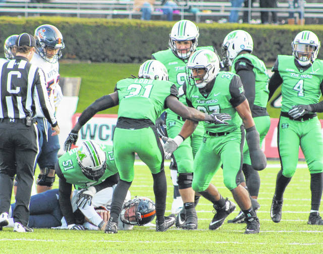 Marshall defenders Omari Cobb (31) and Chase Hancock (37) celebrate a sack during the second half of Saturday's football contest against Texas San Antonio at Joan C. Edwards Stadium in Huntington, W.Va.