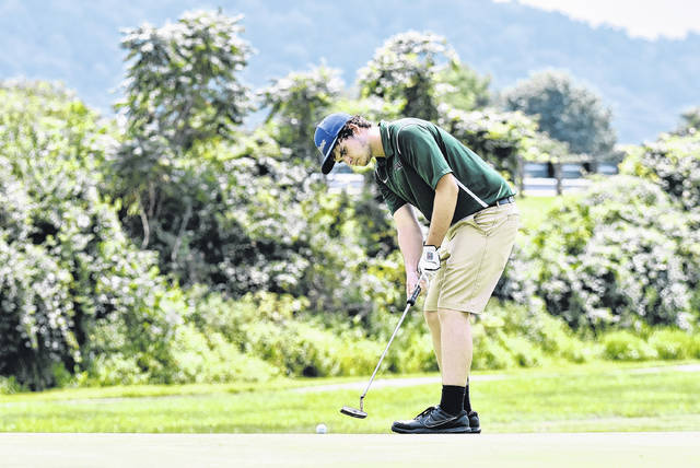 EHS senior Ryan Harbour attempts a putt during a match on August 7 at Cliffside Golf Course in Gallipolis, Ohio.