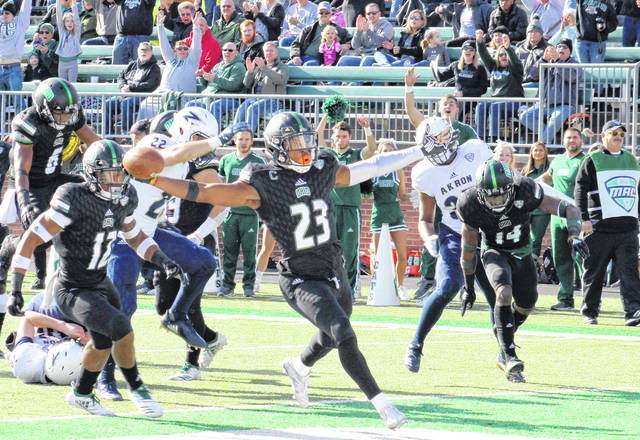 Ohio senior Kylan Nelson (23) returns a punt for a touchdown, during the Bobcats' 21-point victory over Akron on Friday in Athens, Ohio.