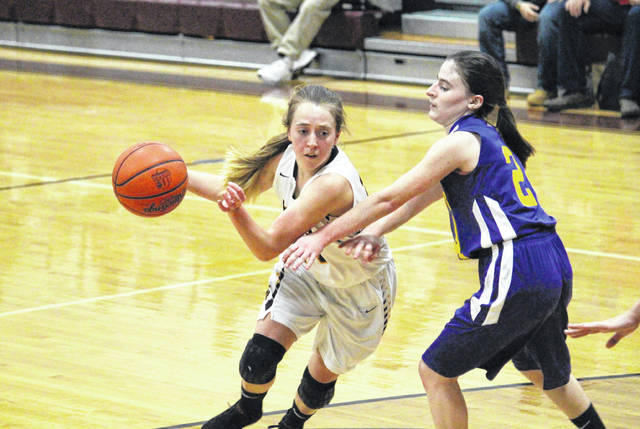 Meigs senior Madison Fields (left) drives past Southern freshman Brooke Crisp (right), during the Lady Marauders' 90-24 victory on Monday in Rocksprings, Ohio.