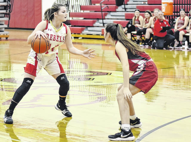 SGHS freshman Jessie Rutt (11) dribbles the ball against a Symmes Valley defender during Tuesday night's 54-45 setback to the Lady Vikings in Mercerville, Ohio.
