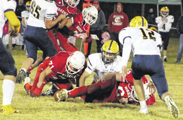 Wahama junior Wesley Peters (71) recovers a fumble, during the White Falcons' season finale on Friday in Mason, W.Va.