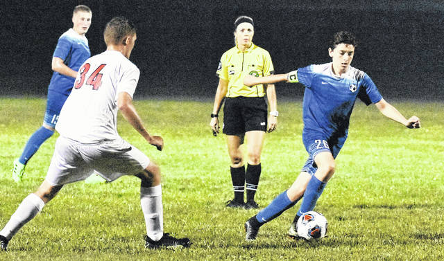 GAHS freshman Brody Wilt controls the ball during the Blue Devils Ohio Valley Conference contest against Portsmouth on Sep. 13 in Centenary, Ohio.