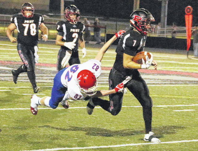 Point Pleasant senior Cason Payne (7) drags a Herbert Hoover defender during a second half run in a Week 4 football contest at OVB Field in Point Pleasant, W.Va.
