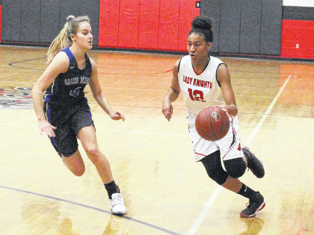 Point Pleasant freshman DaNayla Ward (12) dribbles past Gallia Academy's Alex Barnes during the first half of Thursday night's girls basketball contest at Point Pleasant, W.Va.